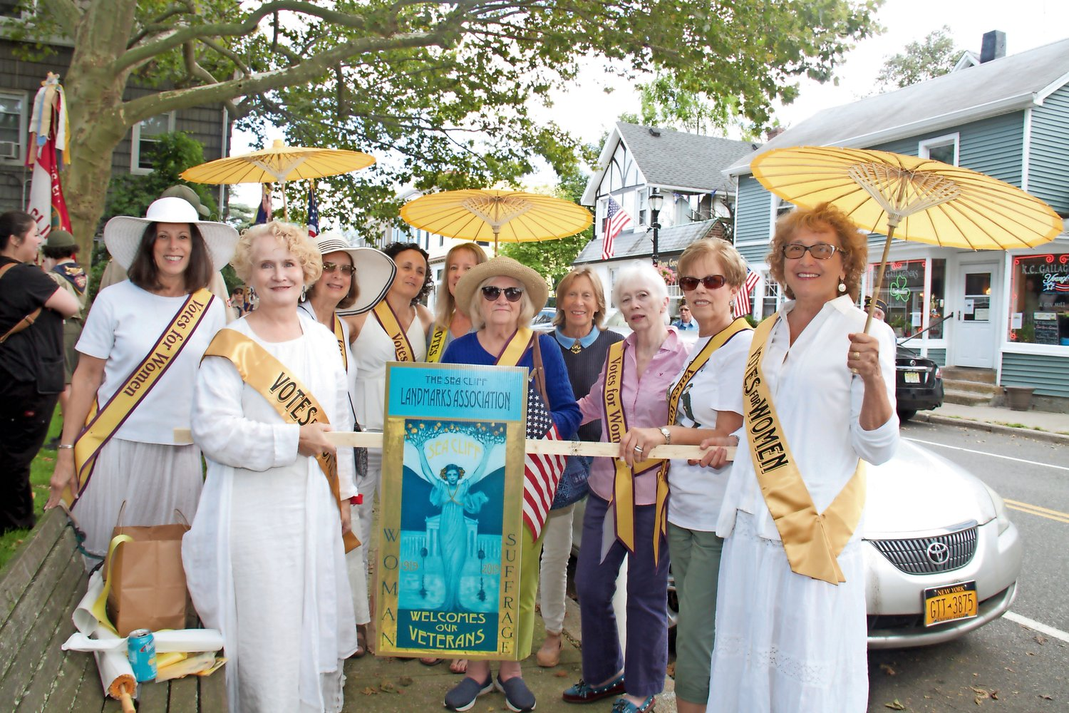 Members of the Sea Cliff Landmarks Association represented women's suffrage.