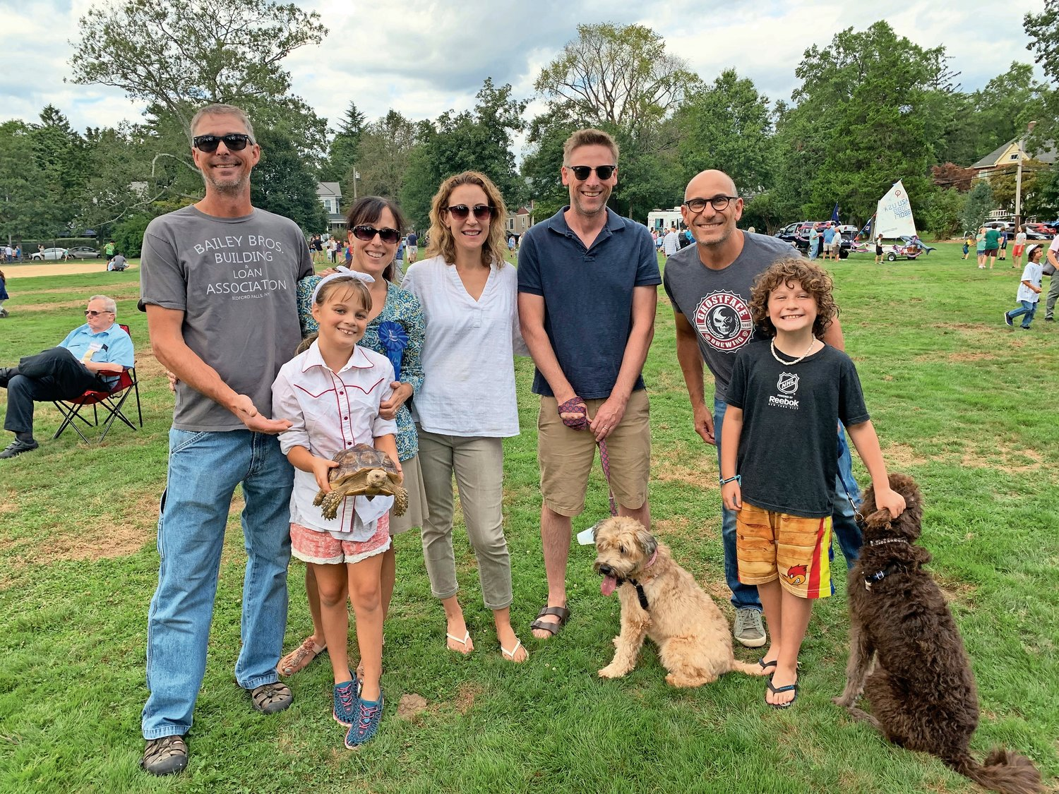 Jeff Jackson, top left; Shannon Meserve; Jess and Eric Ward; Eric Solomon and his children; and Lucy Jackson, bottom left, and Casey Solomon, both 9, brought Shelby, a tortoise; Mabel, a wheaten terrier; and Duncan, a Labradoodle.