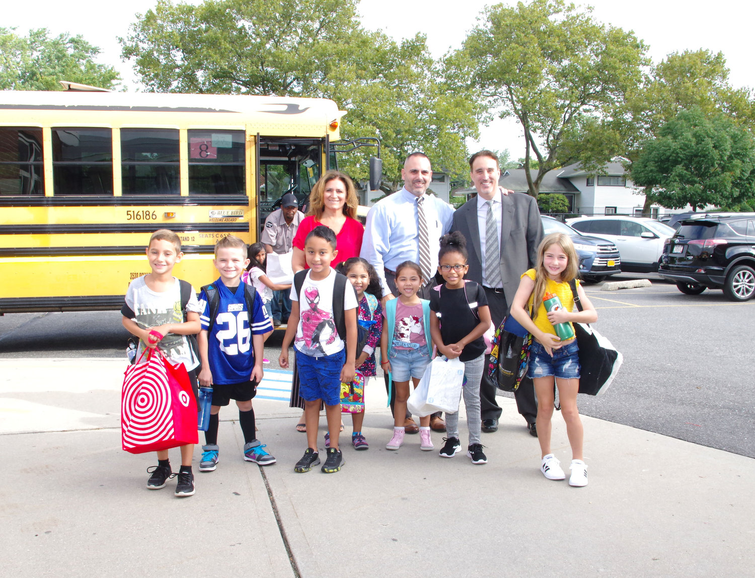 Assistant Principal Harriet Alfano, left, Principal Gregory Bottari and Patrick Pizzo, the district assistant superintendent for business and finance, greeted students as they entered the building.