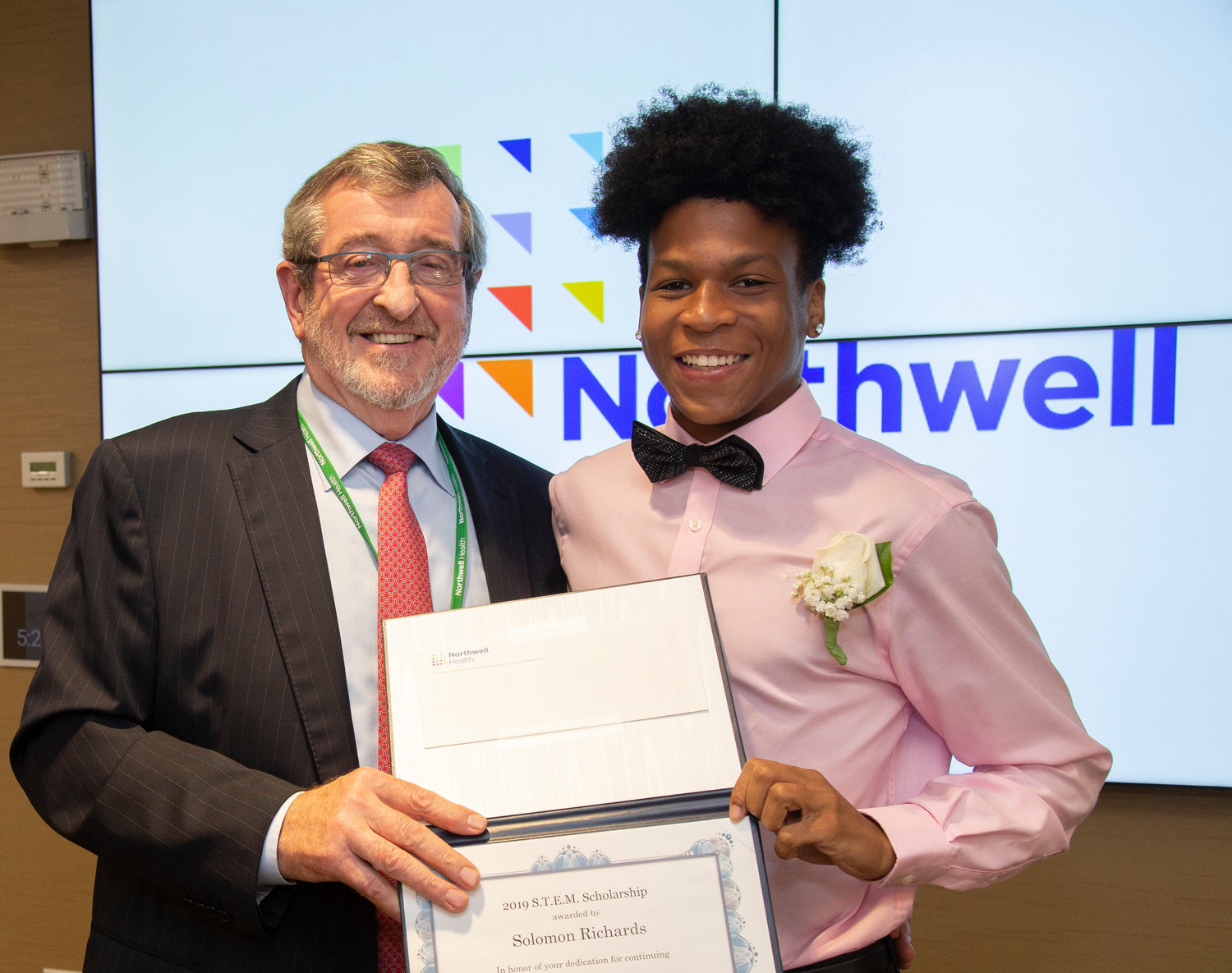 Valley Streamer Solomon Richards, right, with Northwell Health president and chief executive officer Michael Dowling. Richards received a $7,500 scholarship from the network.