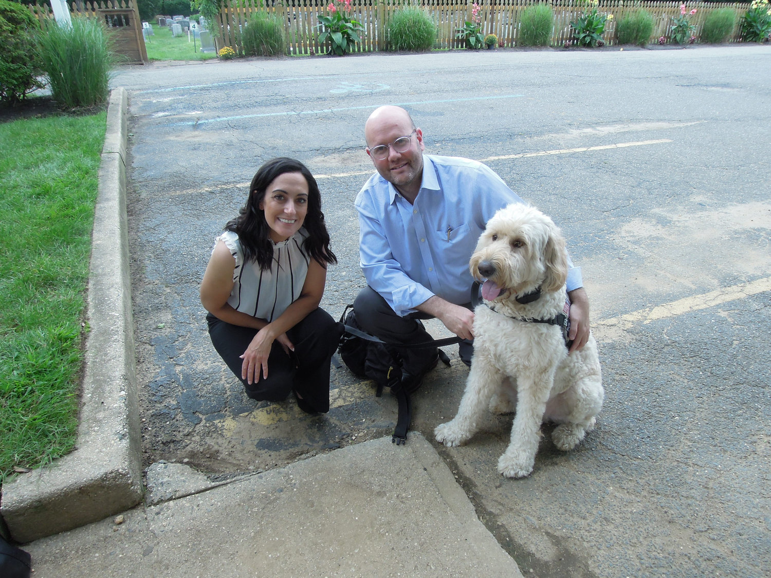 Comforted Companions pet hospice founder Dr. Alexis Tishler, left, with Jaime Hazan and his service dog, Bernie.
