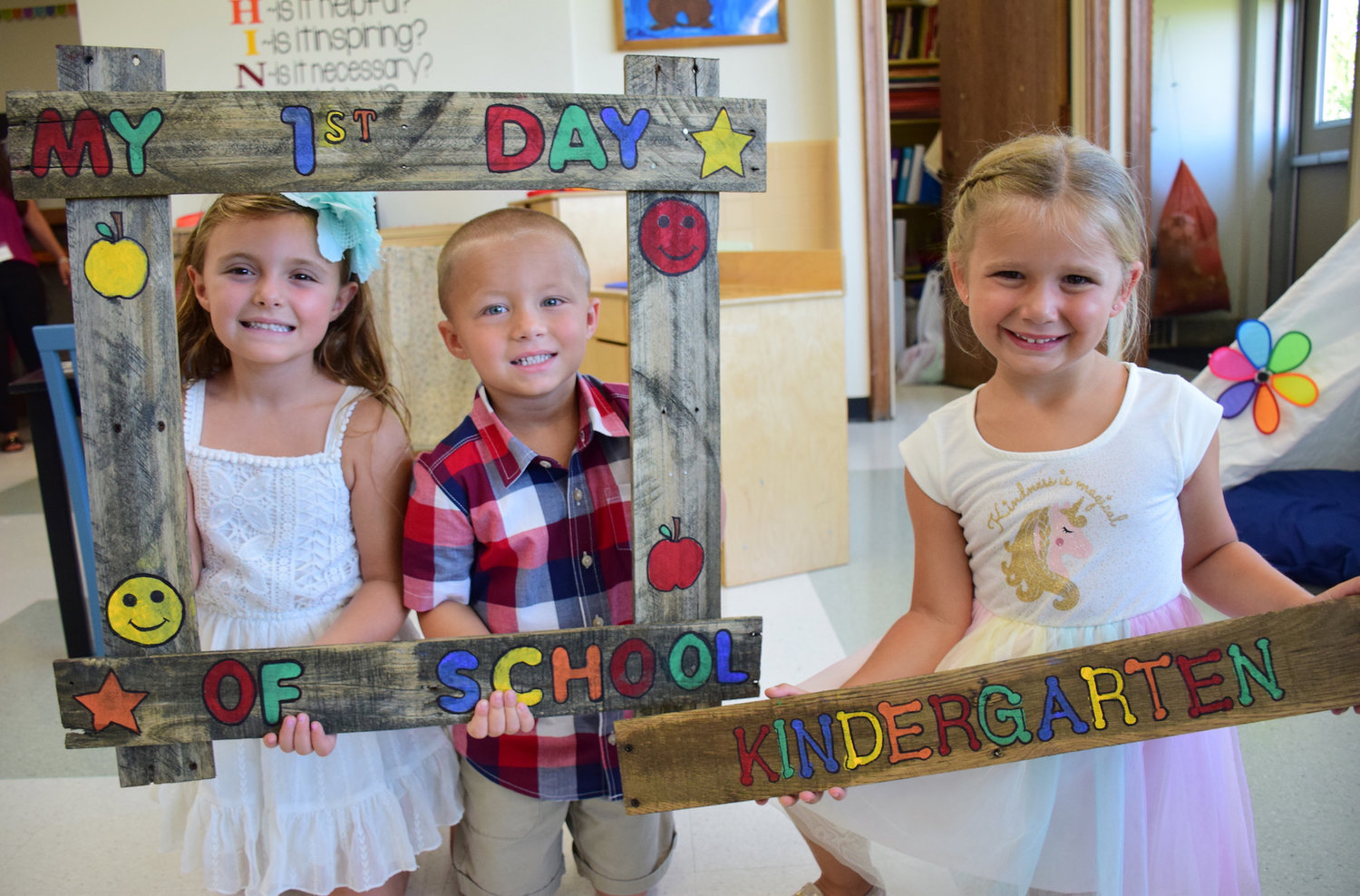 Seaford Manor Elementary School kindergartners, from left, Olivia Mascioli, Mason Kanover and Molly Davidson were excited for their first day of school.