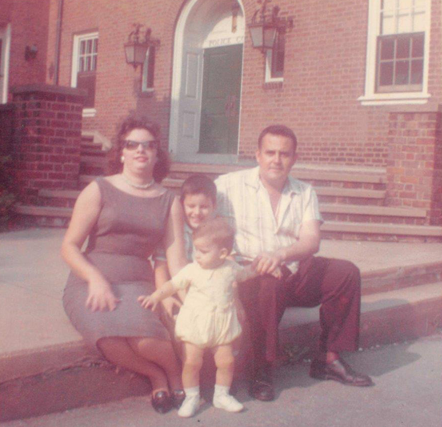 Bermudez and his family moved to Freeport from Cuba when he was 9 months old. Above, a family portrait on their first day in the village, in front of the Police Department. The future chief is at center, in white.