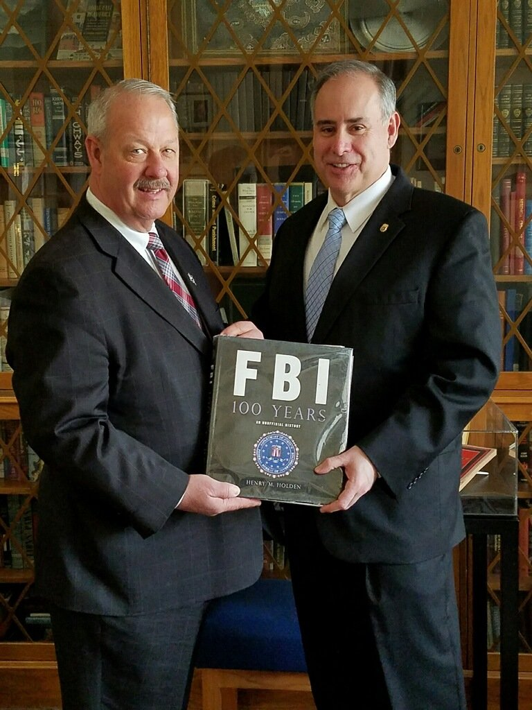 Freeport Mayor Robert Kennedy, left, with Bermudez after he graduated from the FBI National Academy.
