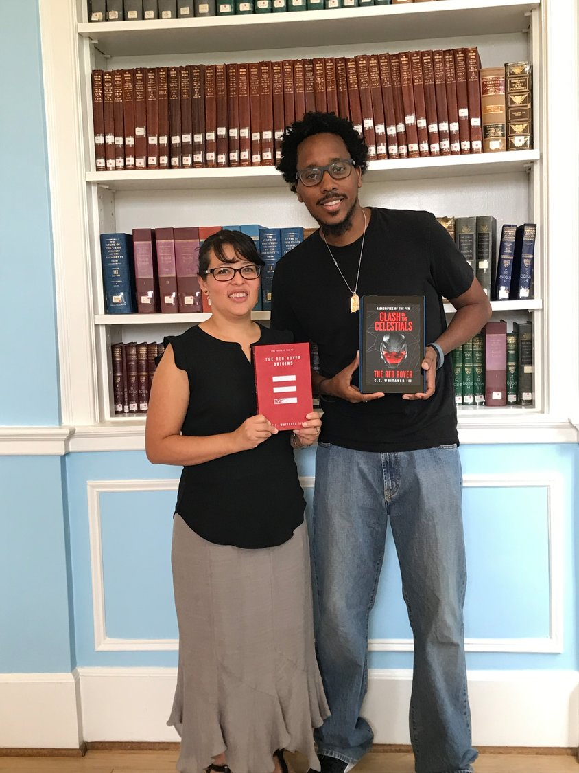 Librarian Cindy Soto, head of the Freeport Memorial Library Children's Department, welcomed Freeport author C.E. Whitaker III to the library.