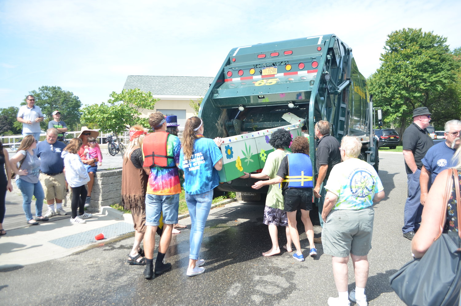 The winners of the race inserted their boat into a sanitation truck after the race.