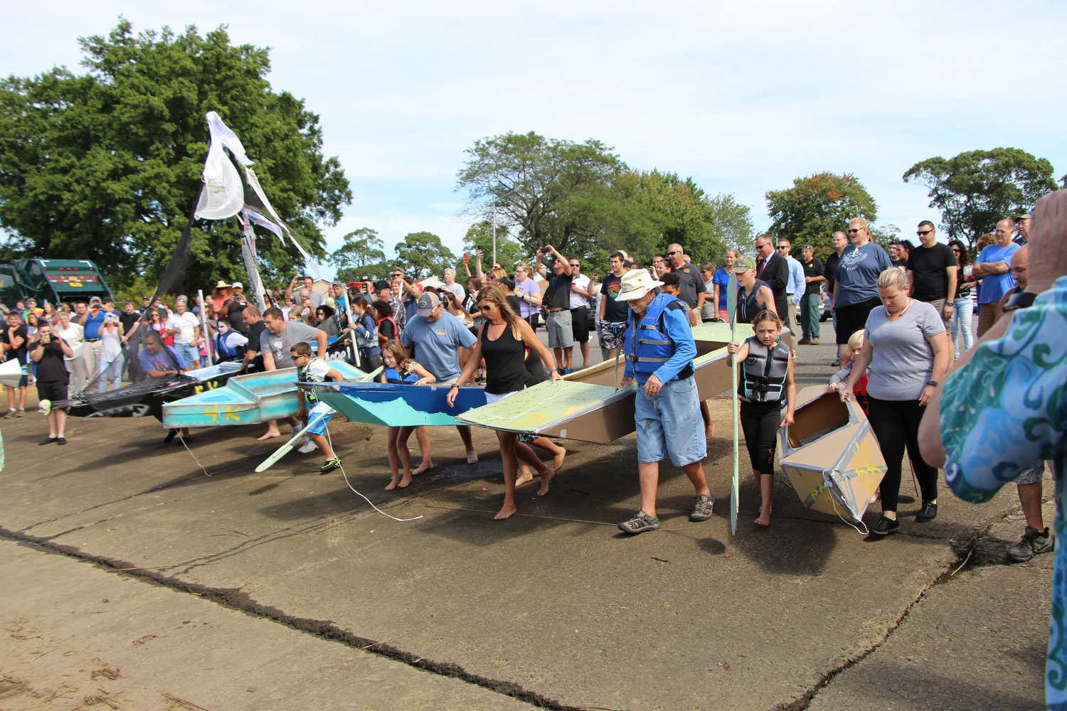 Participants set up their boats for the start of the children's race.