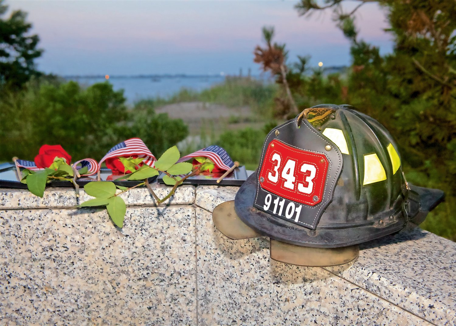 "A helmet represents the 343 firefighters who were killed on Sept. 11 was brought to the podium by FDNY Joseph Siciliano, who read ""The 343,"" a poem by Joe Wasserman."