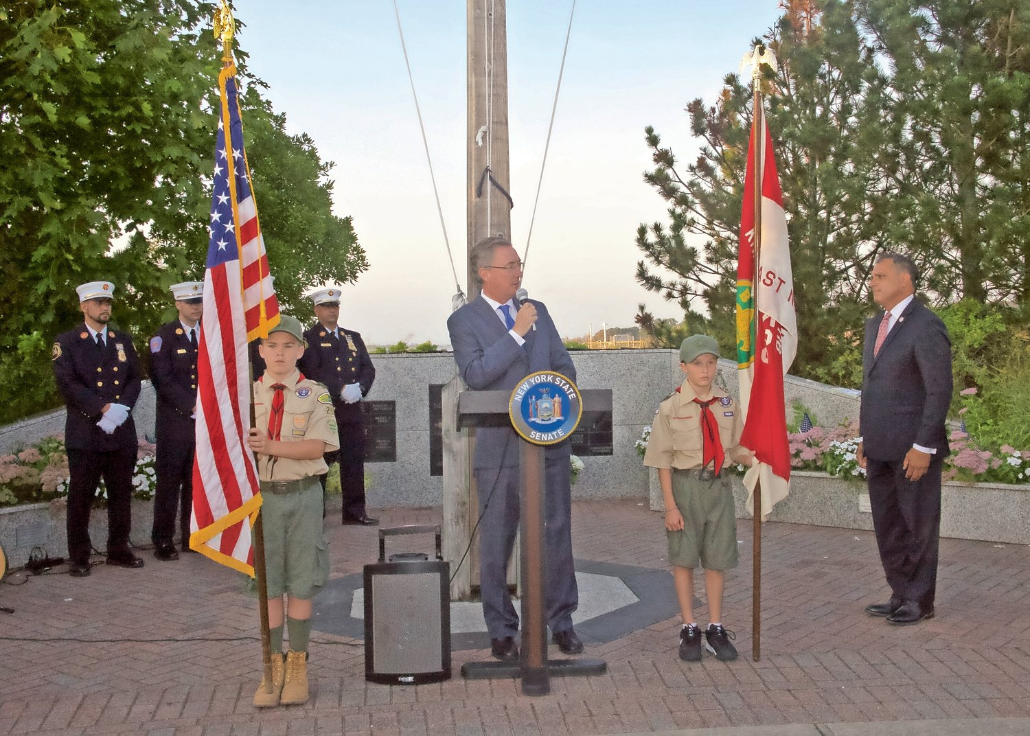 Sen. Jim Gaughran, with Boy Scouts from Troop 253, Brendan Murry, left and Andrew Taylor at his side, introduced Supervisor Joseph Saladino.