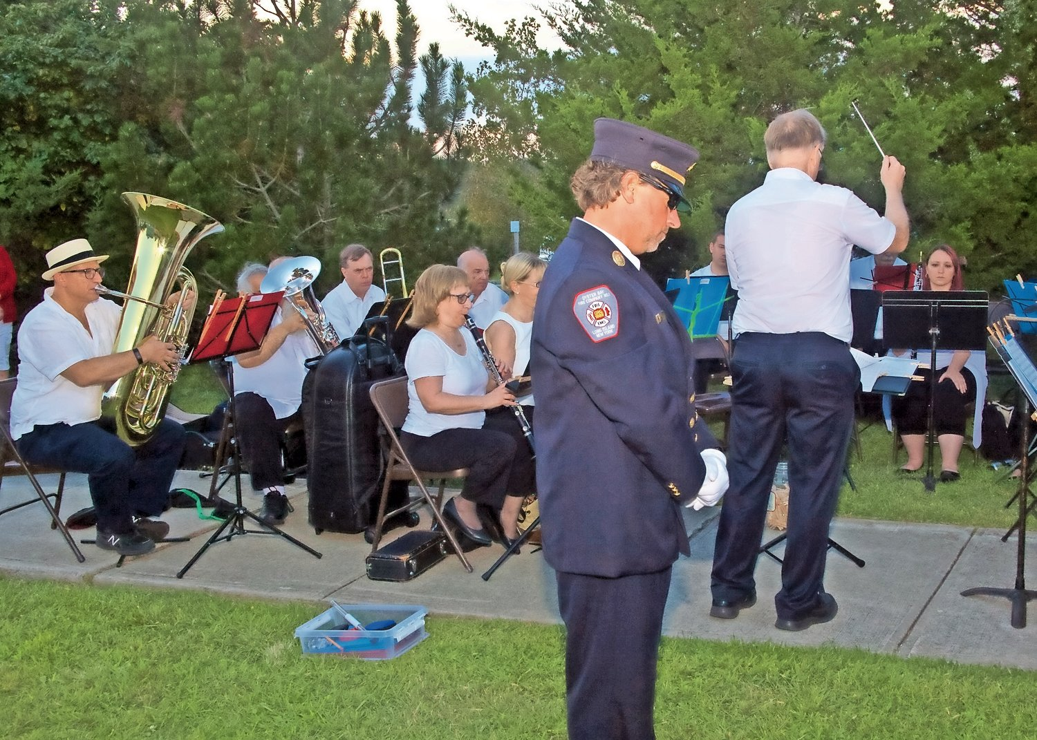 A firefighter from Oyster Bay Fire Company #1 was touched by the patriotic songs performed by the Oyster Bay Community Band.
