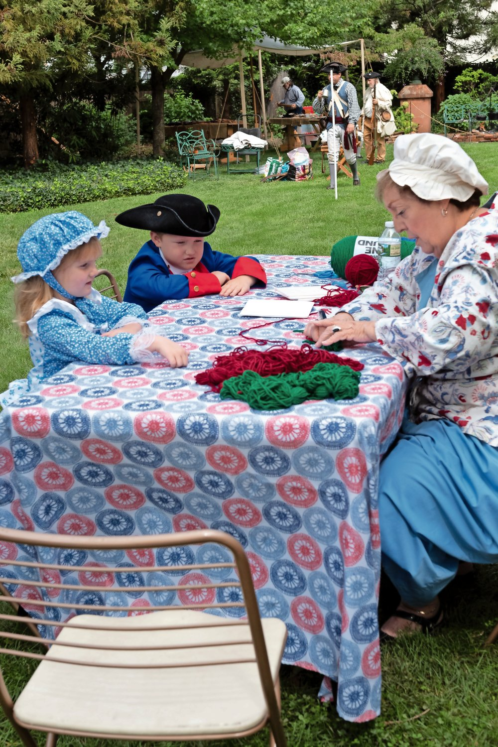 Charlotte and Jaxson Weiss learned about colonial life from JoAnn Paulsen at Raynham Hall's Colonial Day.