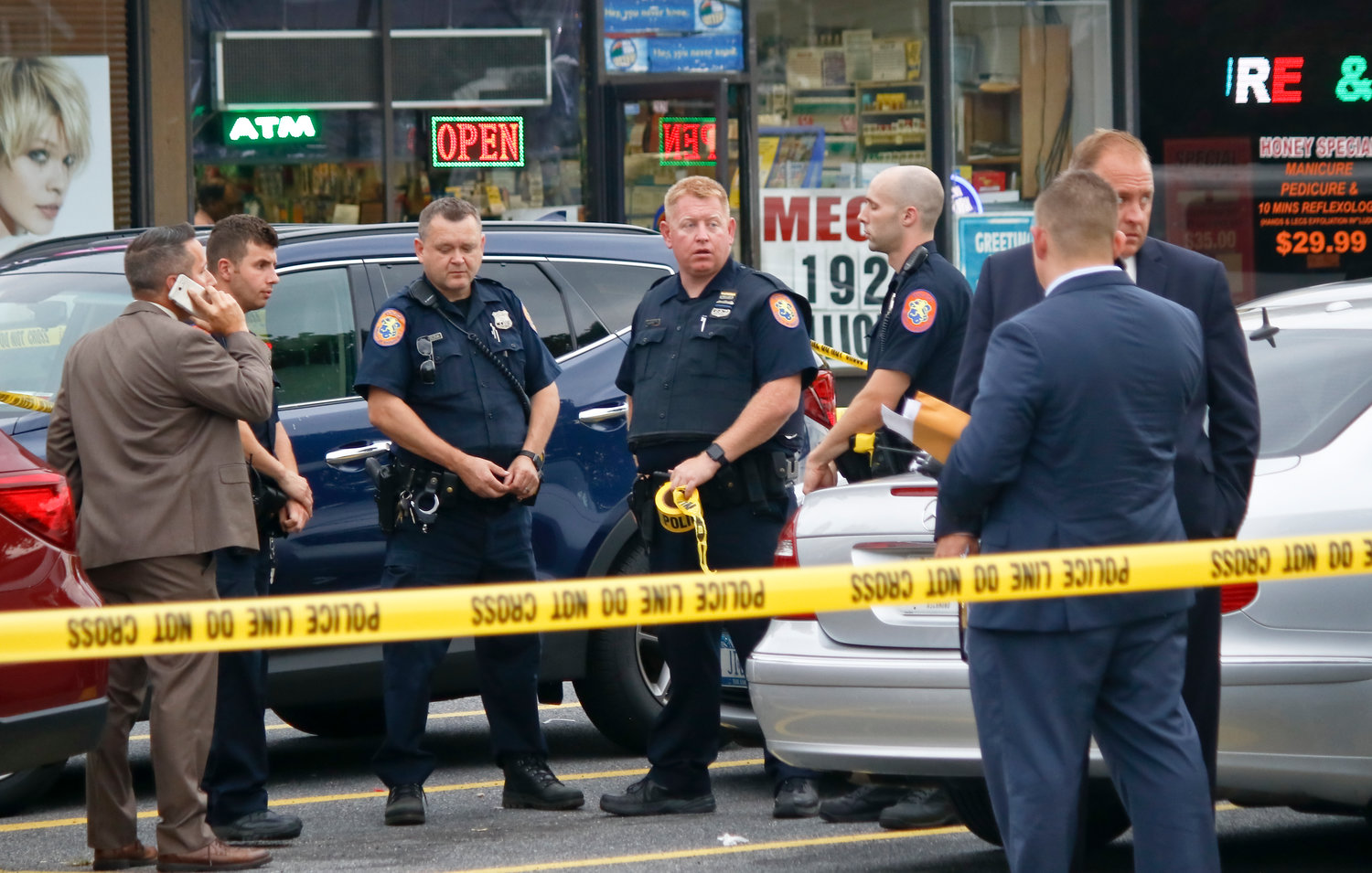 Nassau County police cordoned off the strip mall after a teenager was stabbed on Monday afternoon.