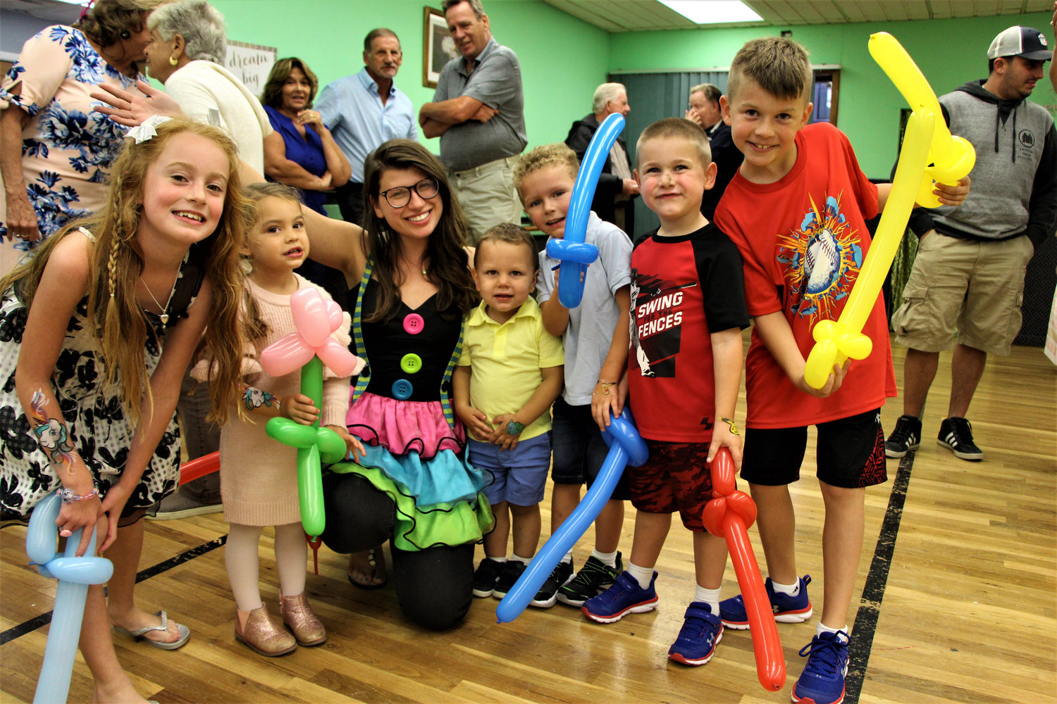 Daniela Ranfone, far left, Gabriella Randazzo, Heather Rose, Justin and John Vaughan, and Sean and Ryan Horbach played with balloons at Pat's Dance Studio's 40th anniversary celebration on Sept. 6.