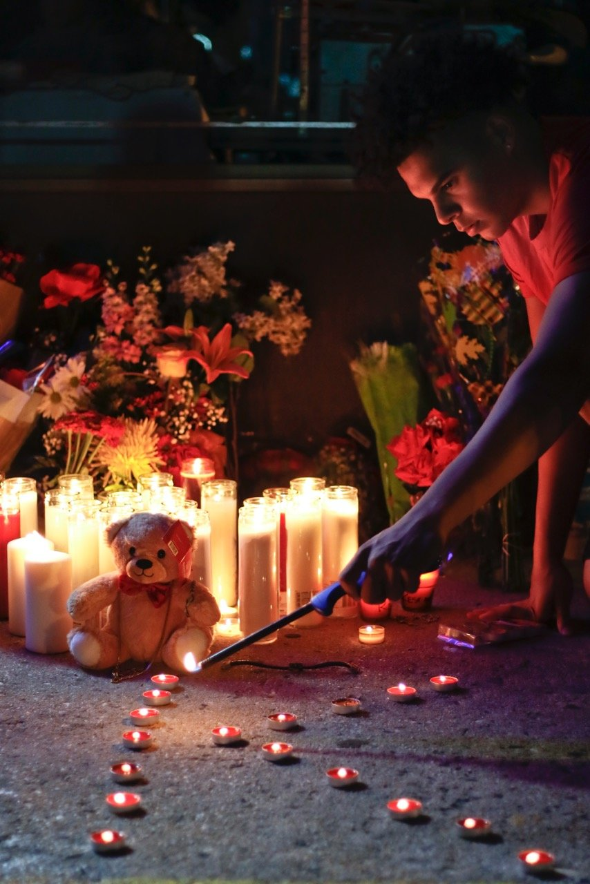 Friends and family of Khaseen Morris gathered for a candlelight vigil on Tuesday night at the Oceanside strip mall where the teen was stabbed to death Monday.