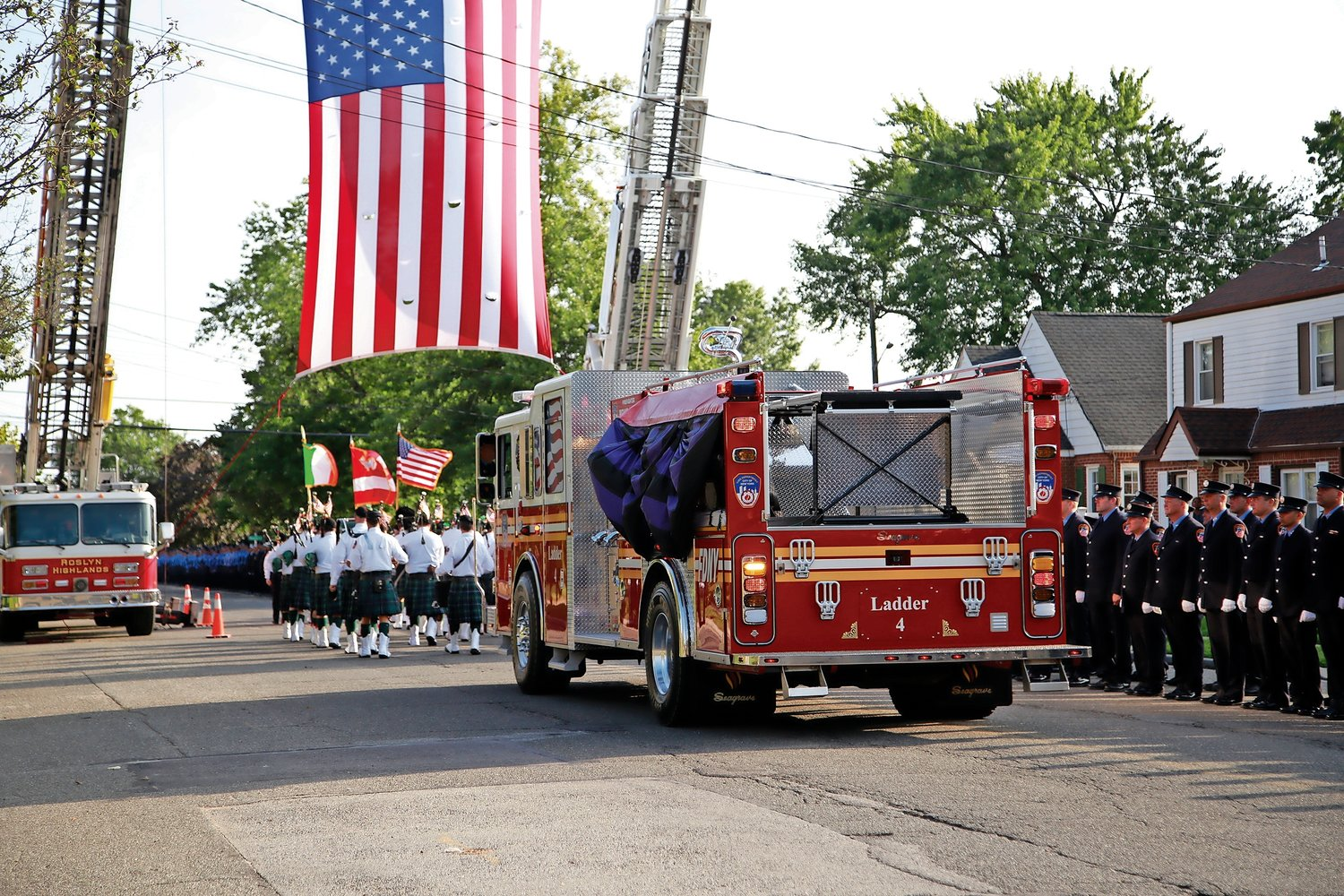 Fire trucks drove down Schrer Boulevard in a processional after the ceremony.
