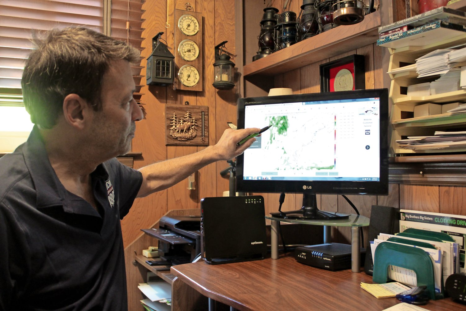 Allen tracks the day's weather forecast on an assortment of weather models from his home office in Merrick.