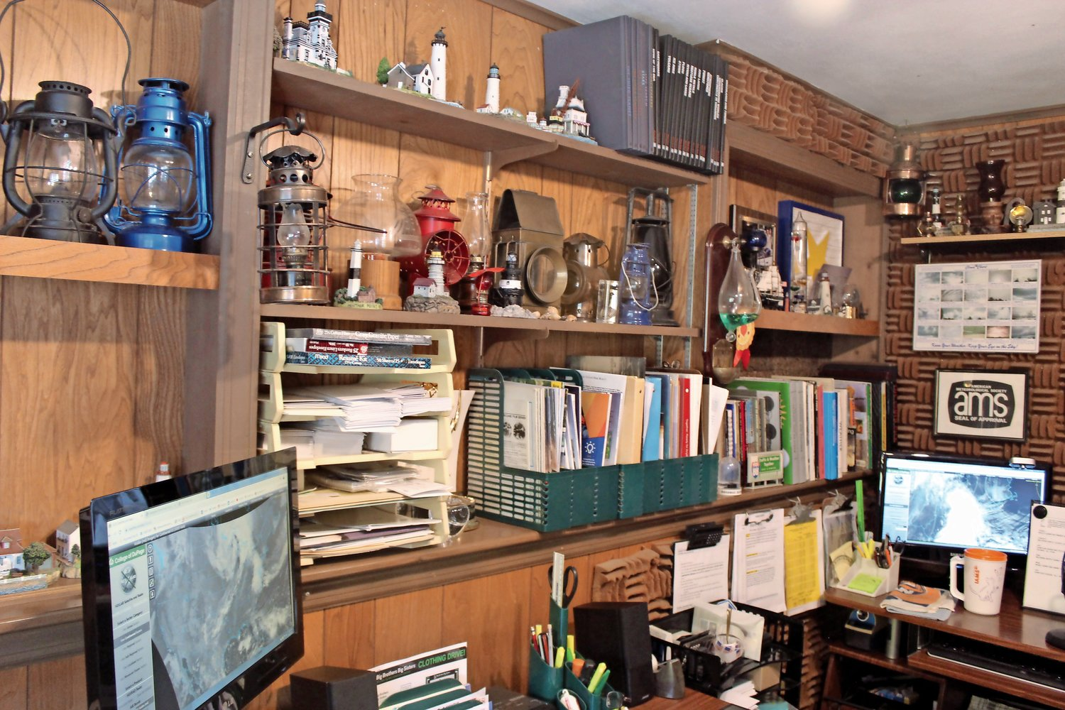 Allen's home office is lined with weather manuals, awards, citations, hurricane lanterns and souvenir lighthouses.
