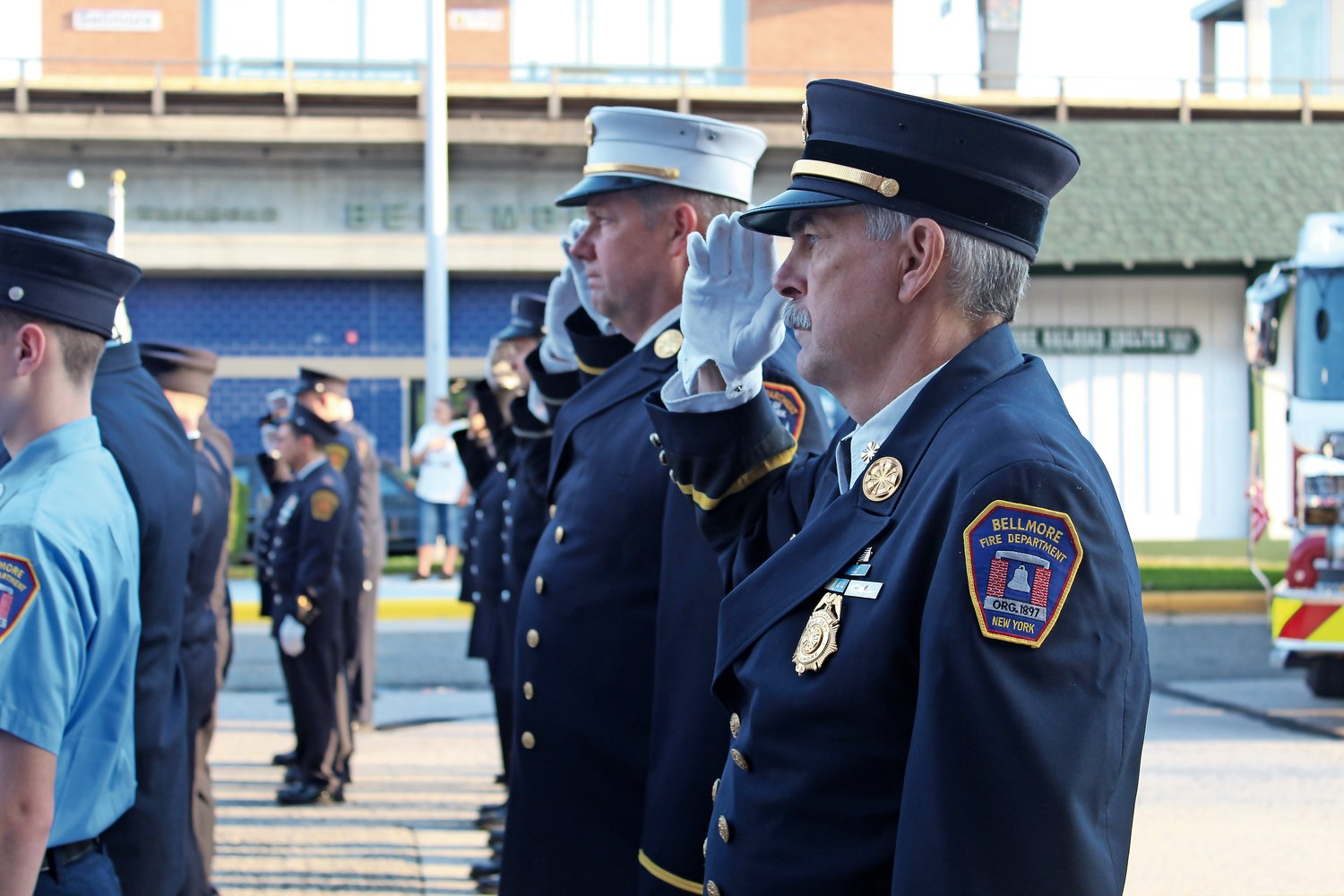 Bellmore Fire Department ex-chief Thomas Stoerger saluted in silence as the ceremony began.