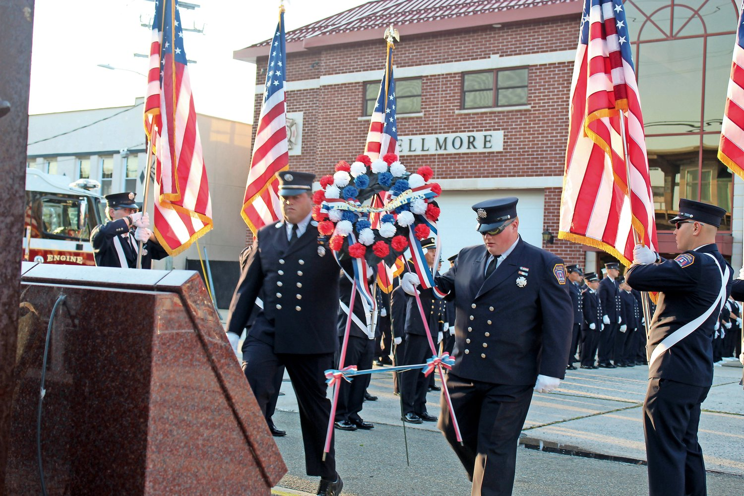 A pair of firefighters carried a memorial wreath bearing Adam Rand's name. Rand was a volunteer with the Bellmore Fire Department and a New York City firefighter. He died in the line of duty during the Sept. 11 terrorist attacks.
