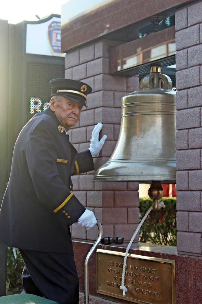 Pete Schmalenberger, Jr., a 65-year member of the Bellmore Fire Department, tolled a bell after each name was read.