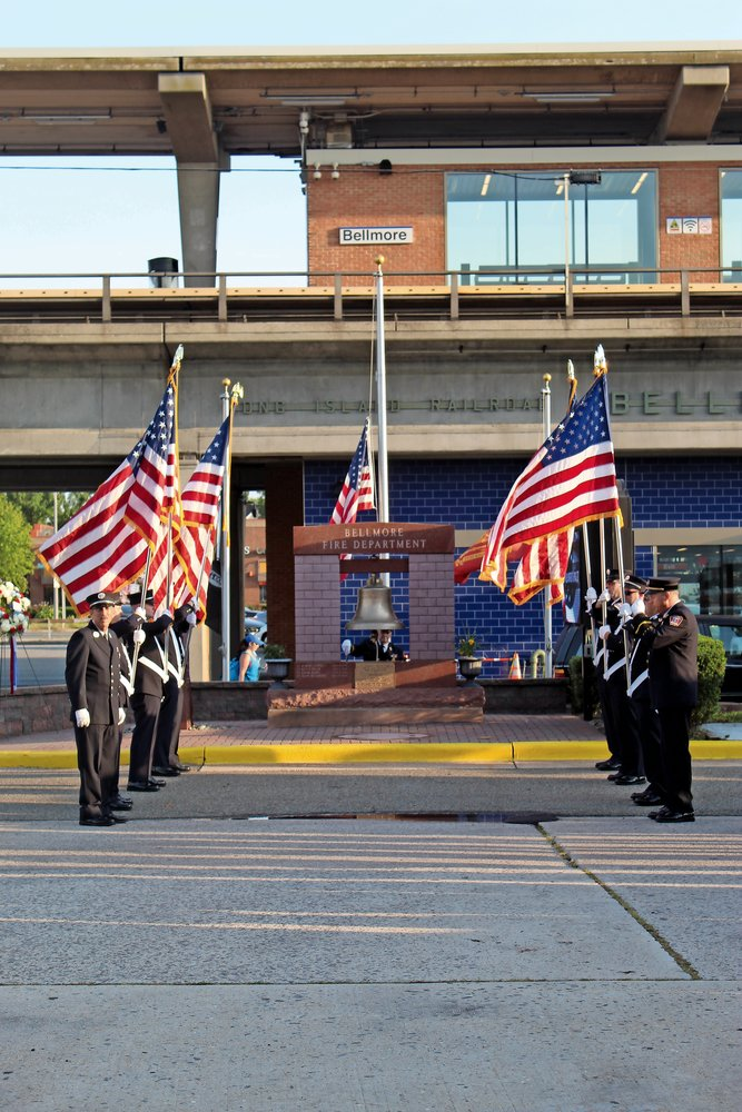 Flag bearers created a patriotic passageway to the department's 9/11 monument.
