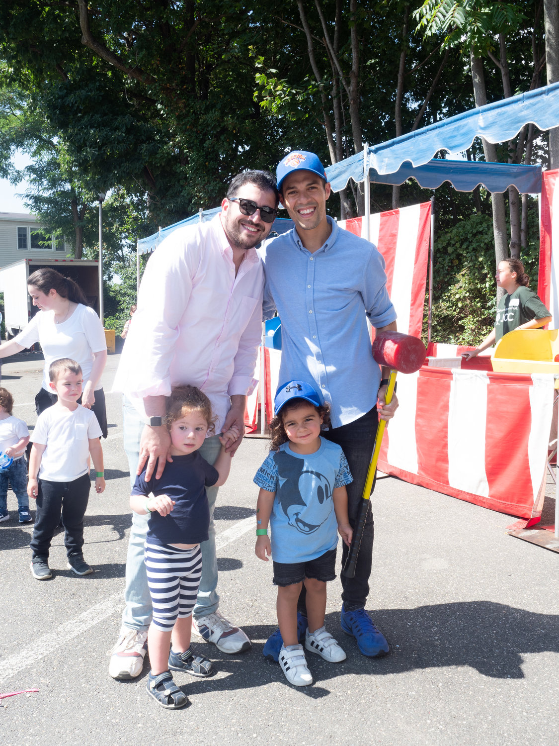 Families joined together at the JCC Fall Festival. Michael Nadjari and Nati Haboura with fathers, Jacob Nadjari, left, and Joseph Ouriel Haboura.