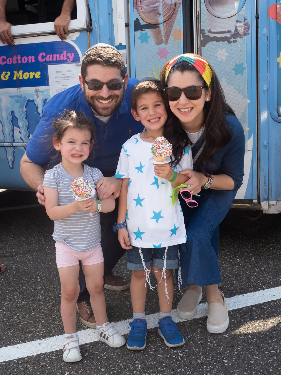 Ice cream was the treat for Zahava, 2, and Meir, 4, Weinstein with parents Yaakov and Davora at the fall festival.
