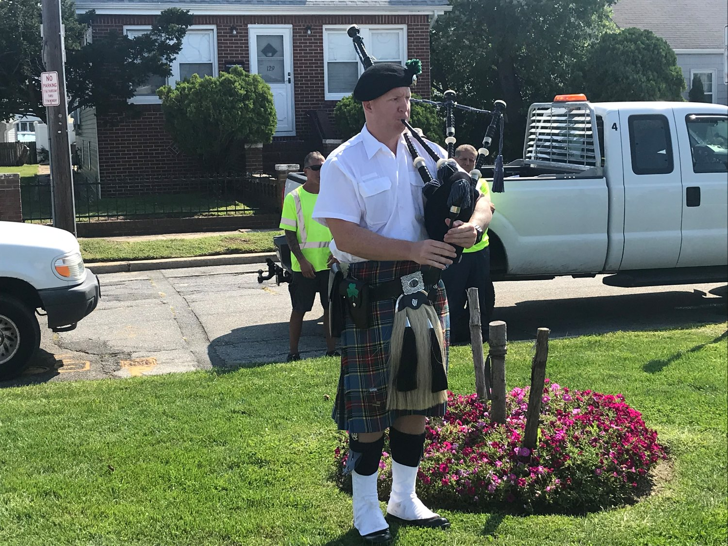 "Rob Hughes performed ""Amazing Grace"" on the bagpipes at the Island Park ceremony."