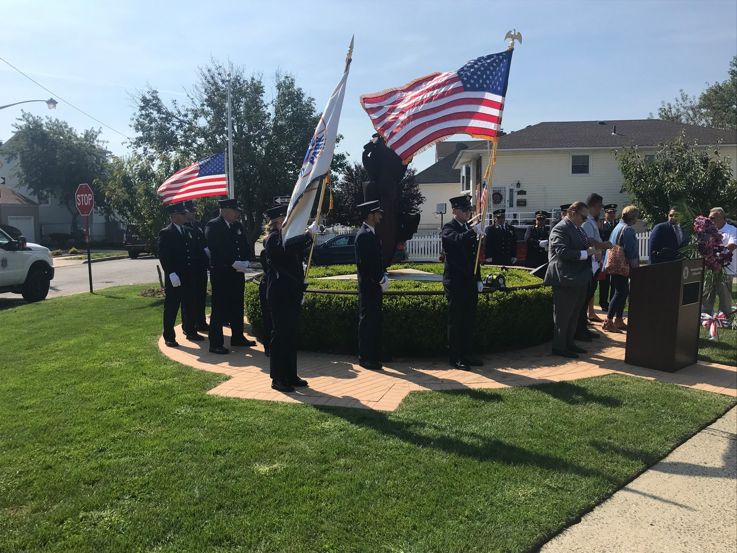 The Island Park Fire Department displayed flags at the village's memorial.