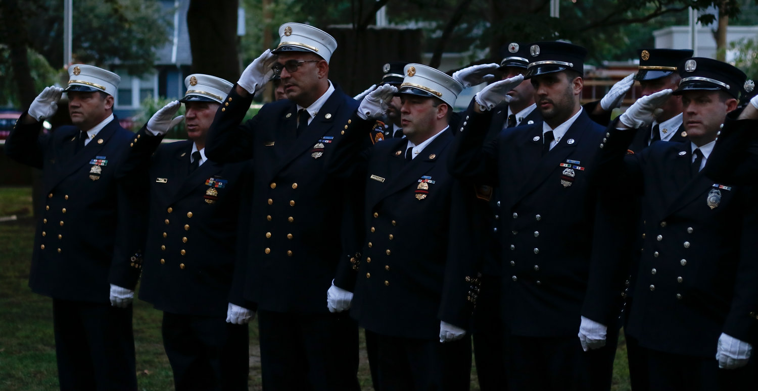 Members of the East Rockaway Fire Department stood at attention.