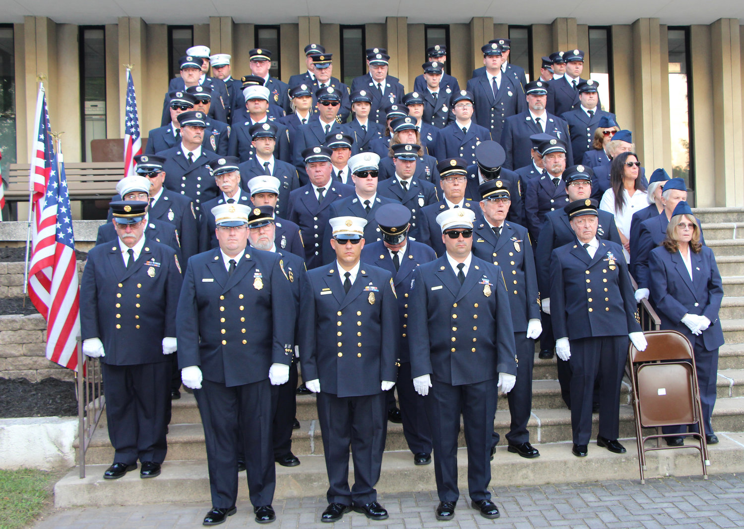 Members of the Lynbrook Fire Department lined the steps to Village Hall.