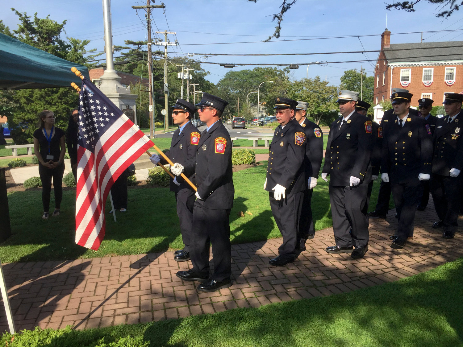 Lawrence-Cedarhurst Fire Department members presented the colors of the flag at the 9/11 remembrance ceremony on Sept. 11.