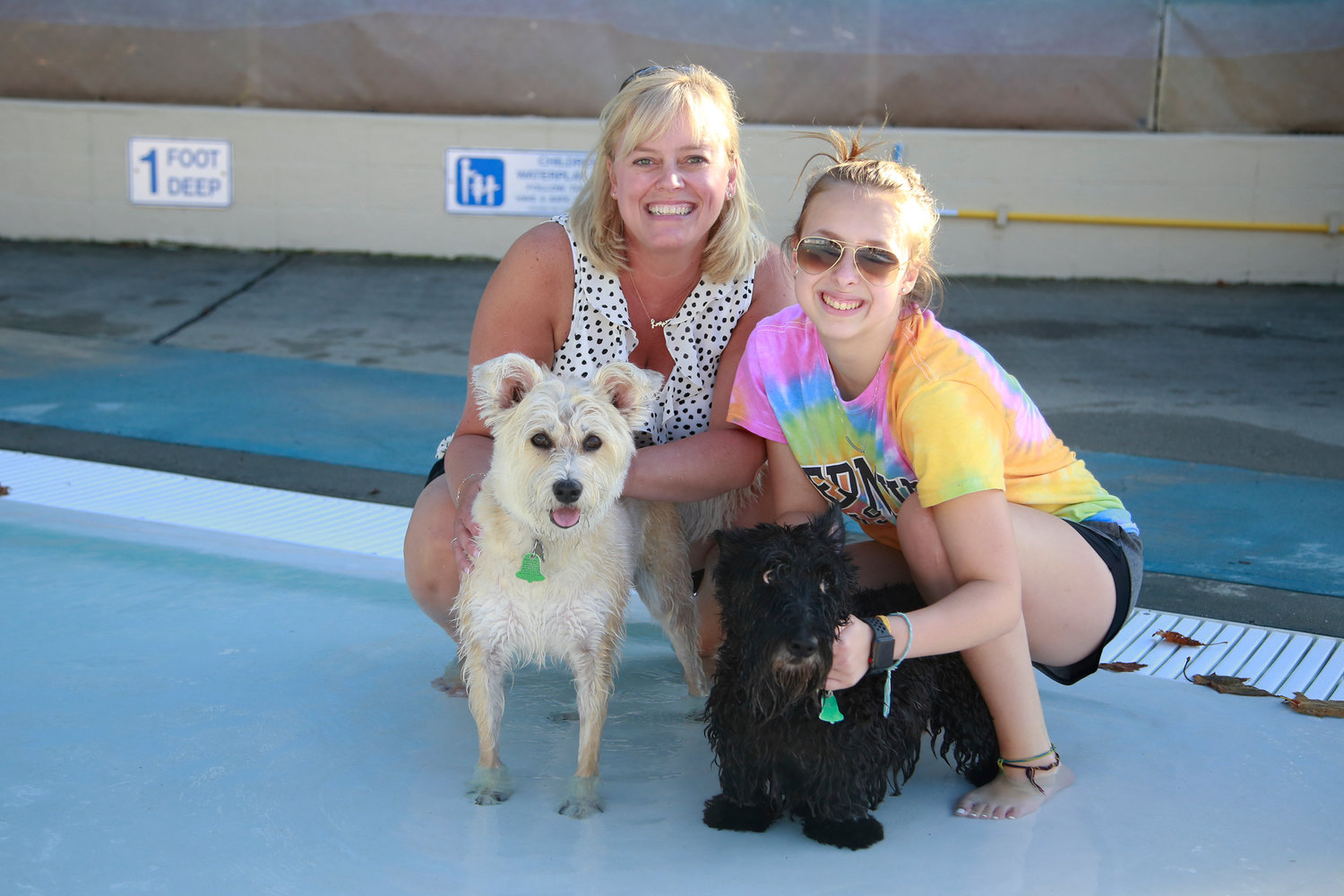 Jennifer and Kate Grande with pooches Bella and Maggie.