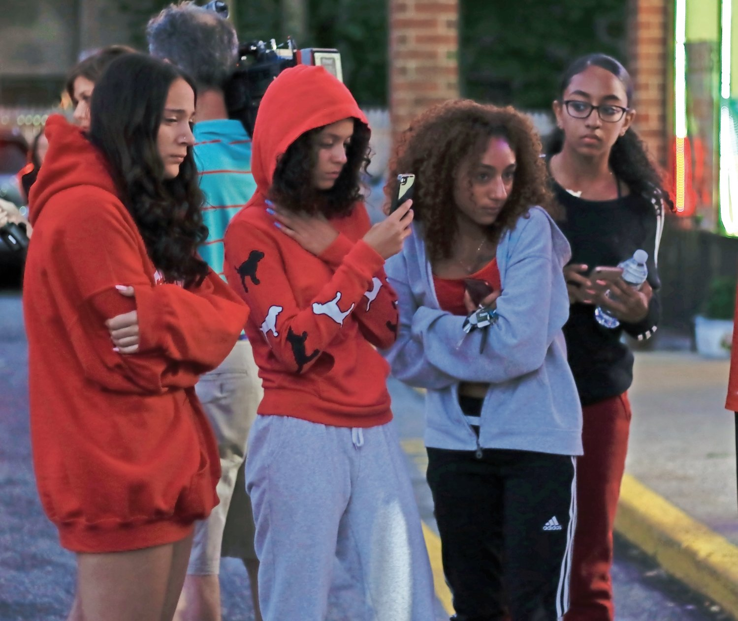 Sophia Emmolo, far left, Leslie Madero and two other friends of Morris's joined the crowd of teens to mourn his death.