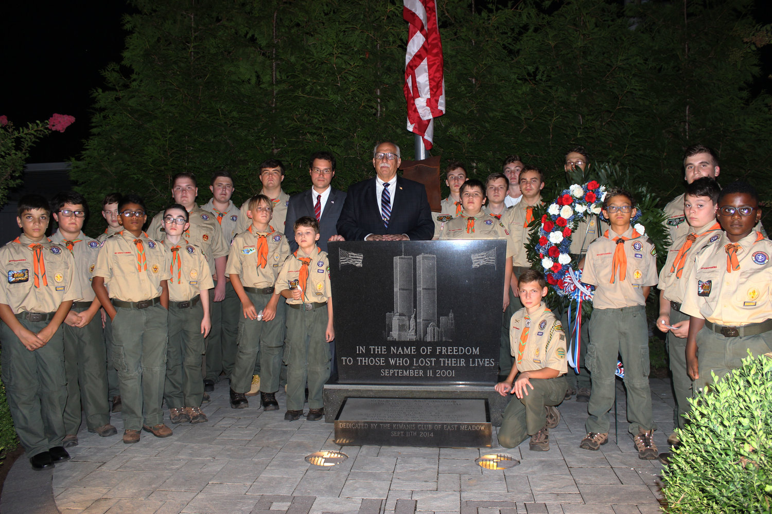 East Meadow Boy Scout Troop 362 paid tribute to those who lost their lives in the Sept. 11 attacks at the East Meadow Fire Department's annual ceremony in Veterans Memorial Park. With them were State Assemblyman John Mikulin and Hempstead Town Councilman Dennis Dunne.