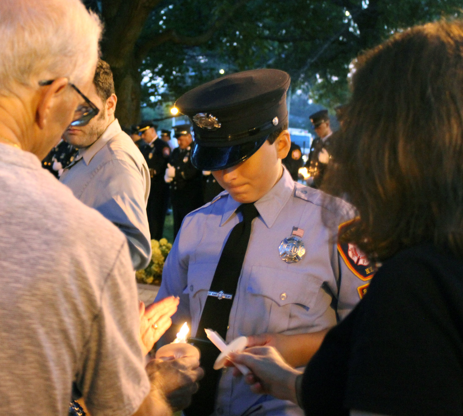 Members of the EMFD's Junior Fire Company greeted attendees and lit their candles for a twilight vigil.