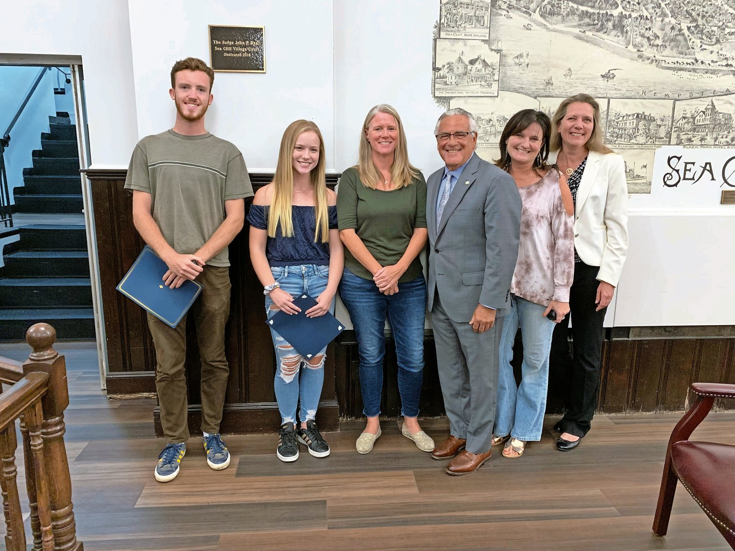 Mayor Edward Lieberman, third from right, awarded certificates to lifeguards Sean Valentine, left, and Cate Salditt, who were joined by Sea Cliff Beach managers Elaine Neice and Joni Sturge and Village Trustee Henriette Rohl.