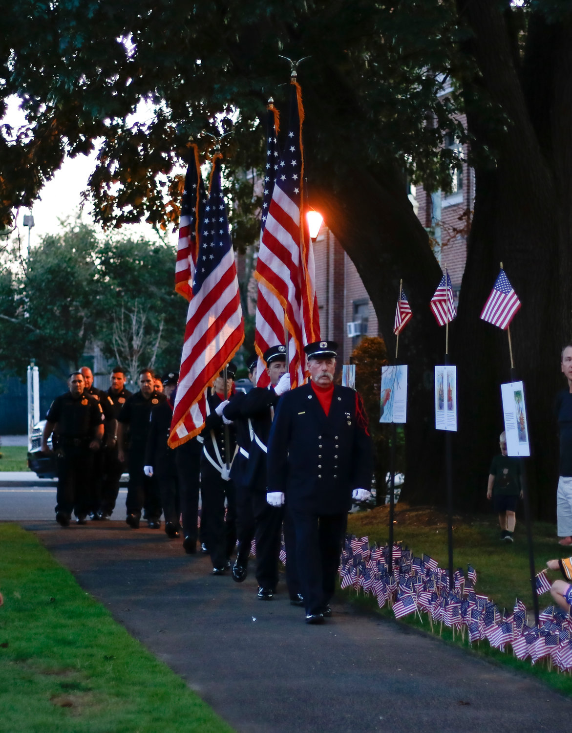 The RVC fire dept. color guard led the procession into the park followed by police officers and firefighters.
