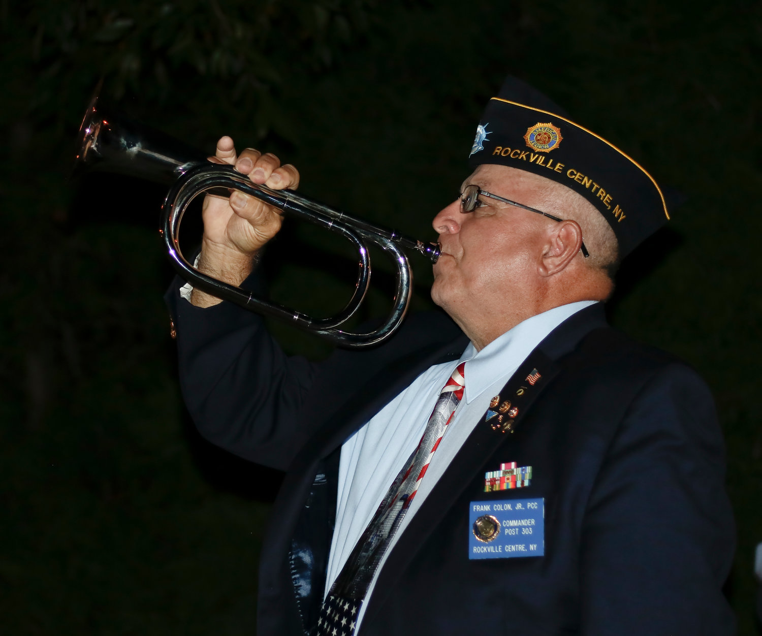 American Legion Post Commander Frank Colon played taps at the end of the ceremony.