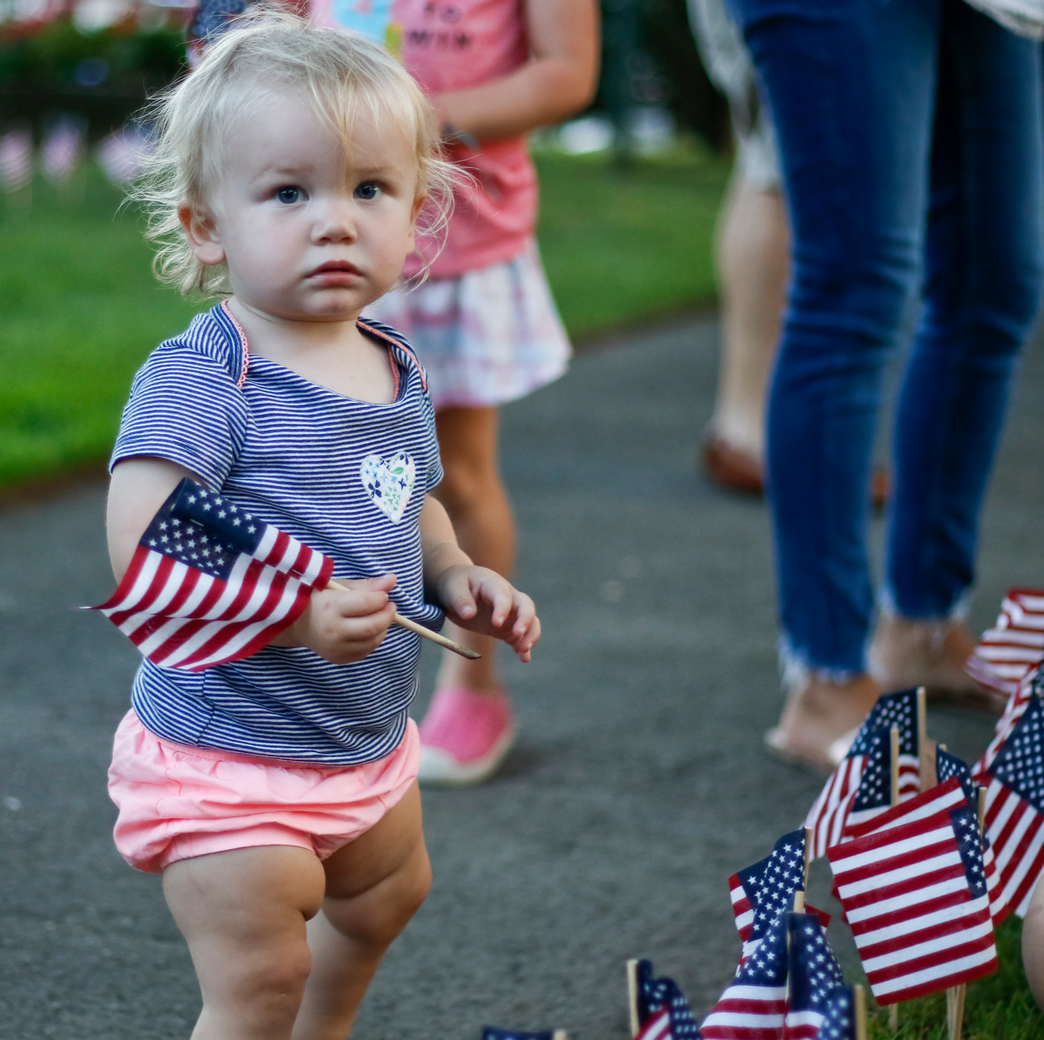 The youngest helper to place a flag was 18-month-old Mary Orosz.
