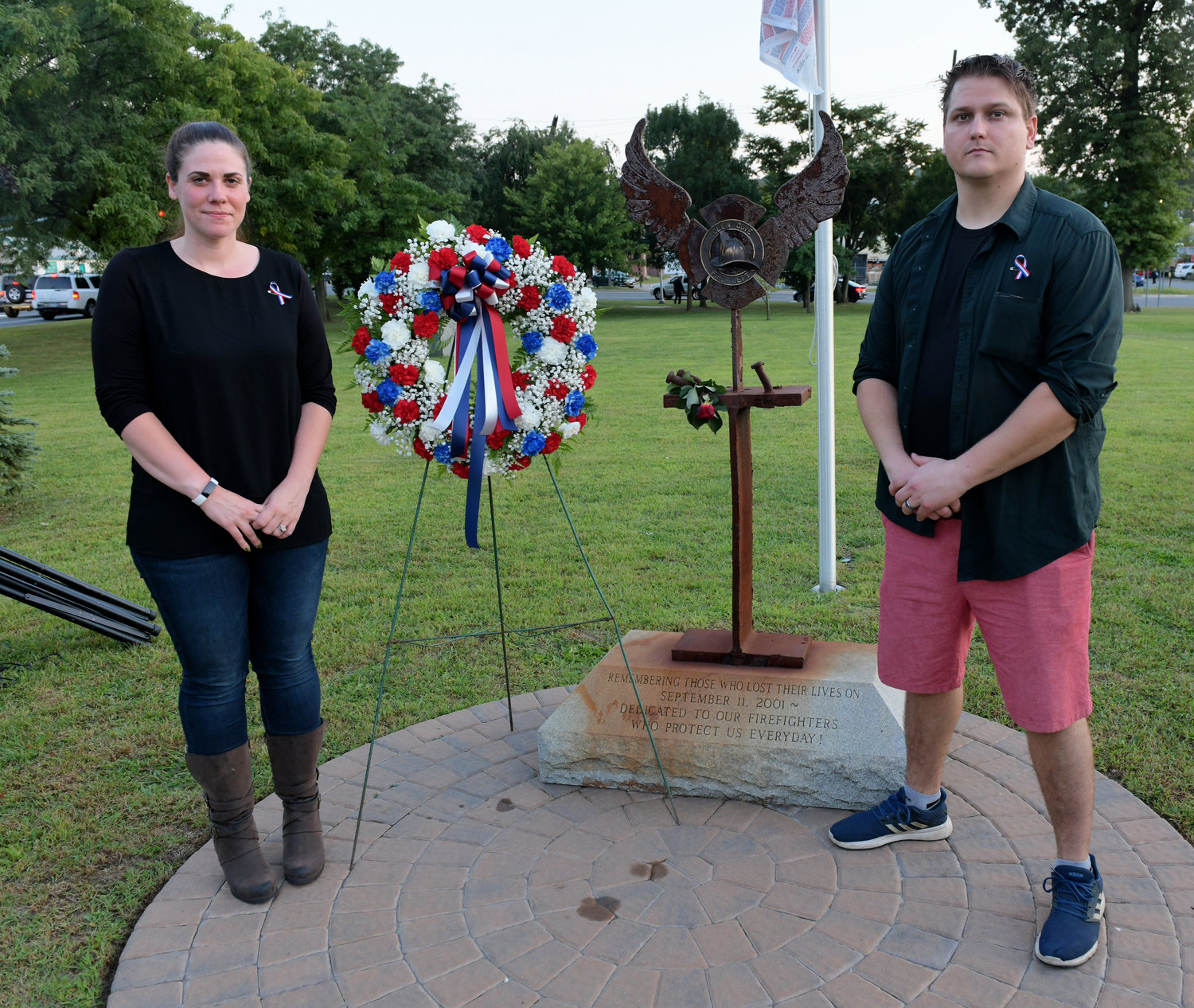 Michele Puckett-Formolo and her husband, Michael, joined the ceremony in honor of her father, John, one of city's four residents who died in the attack.