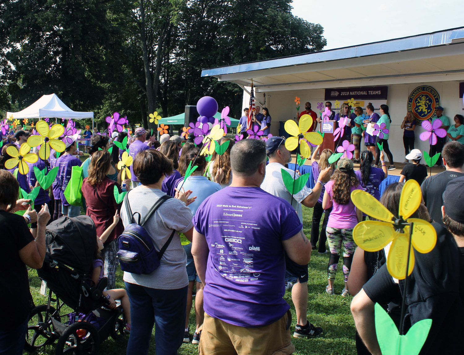 Participants held pinwheels that represented the variety of their relationships with the disease.