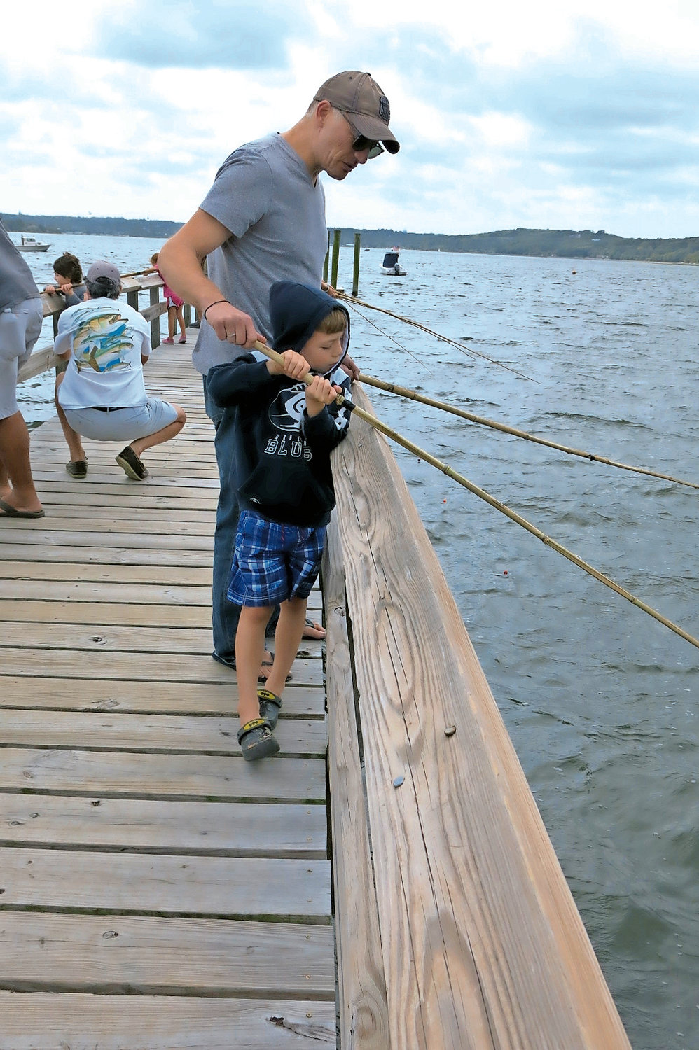 Andrew Themis shared some fishing secrets with his son Andrew.