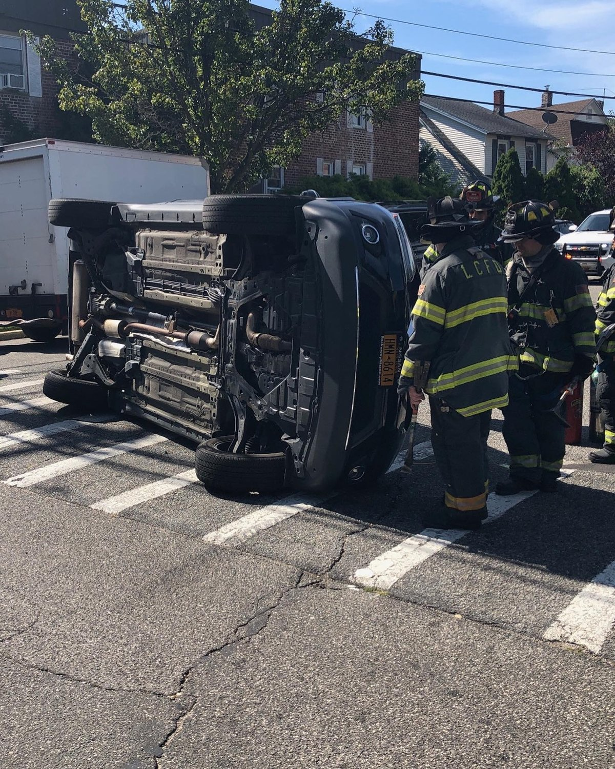 A car flipped onto its left side at the intersection of Cedarhurst and Fifth avenues in Cedarhurst just after 11 a.m. on Sept. 20. Two people were taken to a local hospital.