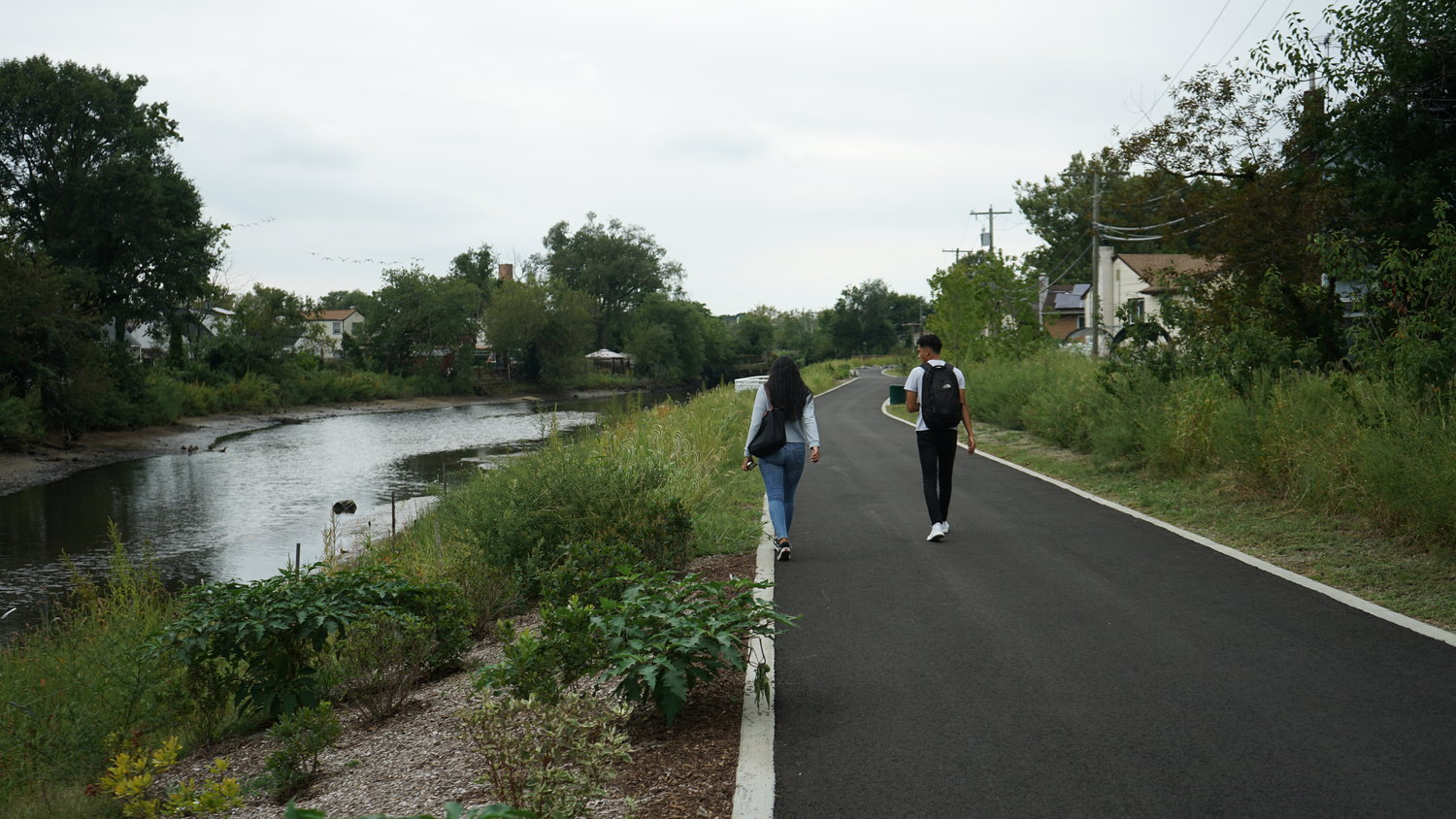 Teenagers walked the Town of Hempstead's new pathway park in South Valley Stream. In addition to providing a scenic walkway, it is also intended to prevent flooding in the surrounding areas.
