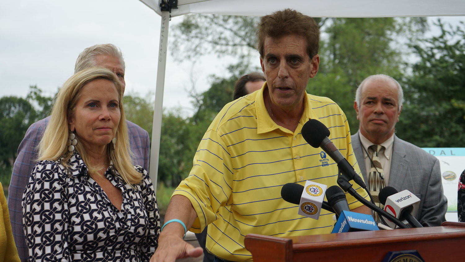 Mill Brook Civic Association Executive Vice President Bob Brown worked with the Governor's Office of Storm Recovery to help design the new flood prevention measures. His house was flooded with four feet of water during Hurricane Sandy. With him was Town Supervisor Laura Gillen, and Marc Tenzer who served as chairman of GOSR's community reconstruction committee for South Valley Stream.