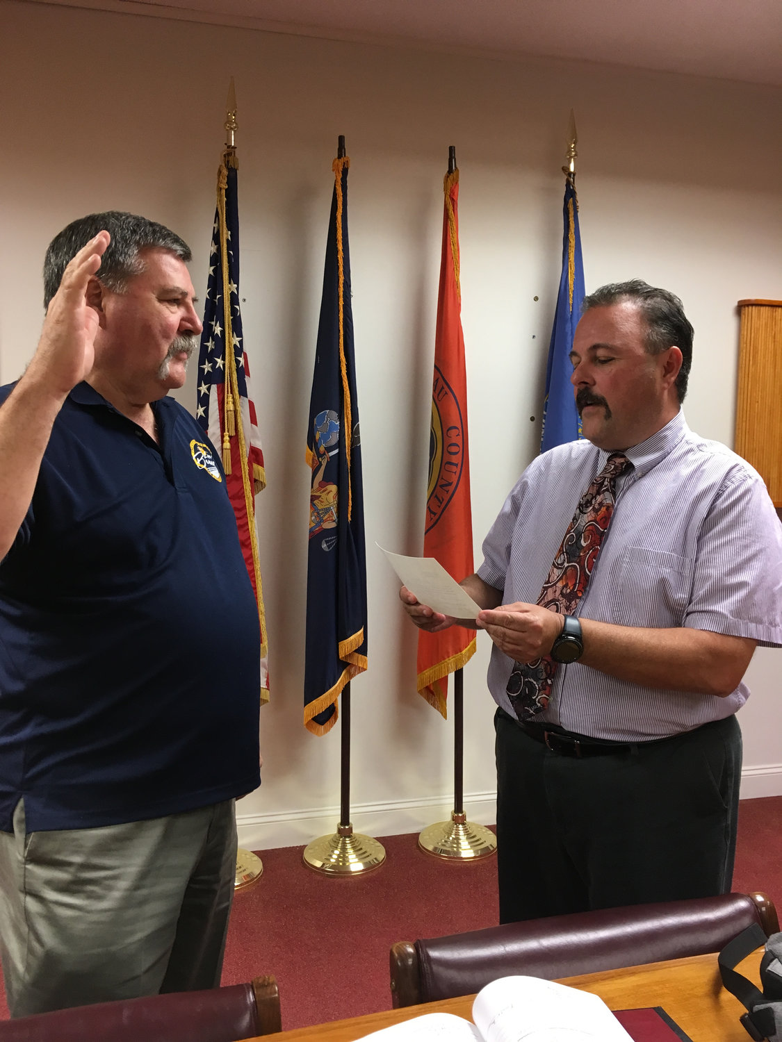 John Mirando, left, the city's commissioner of public works, was sworn in as acting city manager after a special meeting on Tuesday by City Clerk Dave Fraser.