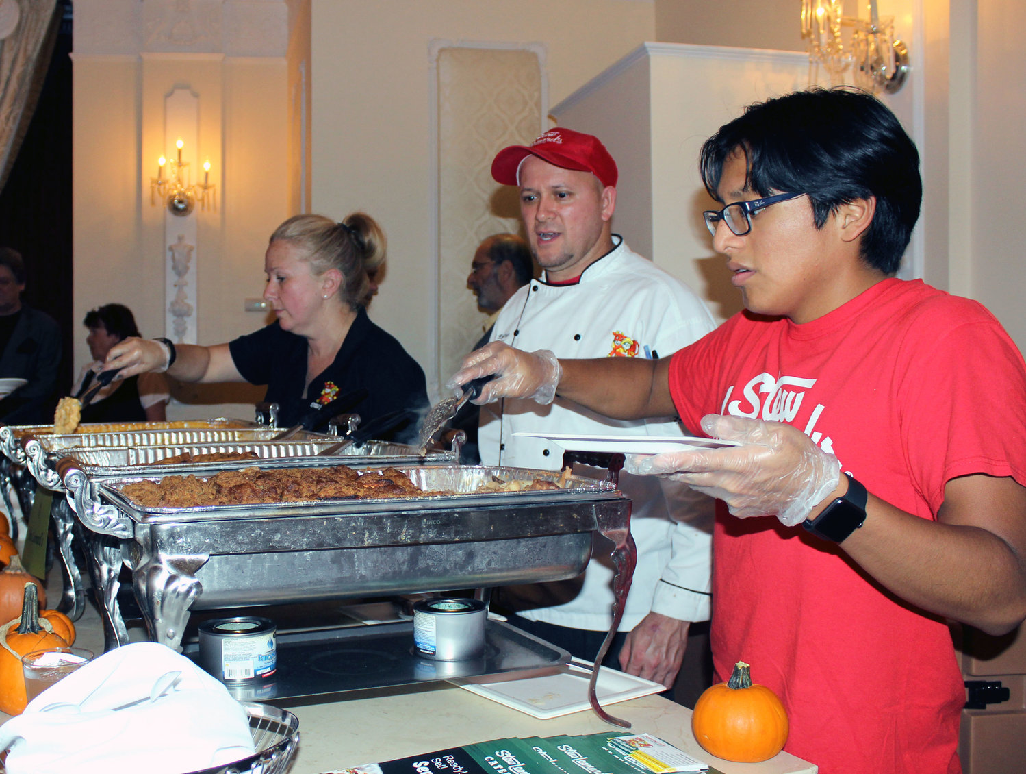 Randi Kopp, far left, German Escobar and Luis Ortega, all of Stew Leonard's in East Meadow, served some of the store's specialties at the 17th annual Culinary Delights, hosted by the East Meadow Chamber of Commerce on Monday.