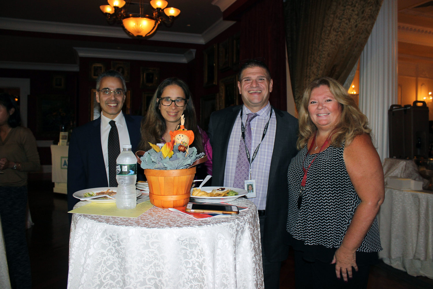 The event drew hundreds of community members, including, from left above, Anthony Russo, the school district's assistant superintendent for personnel and administration; Alisa Baroukh, school board vice president; David Casamento, assistant superintendent for curriculum and instruction; and Eileen Napolitano, a board trustee.