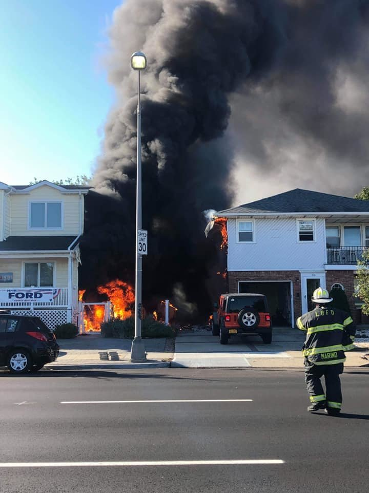 A fire erupted between two houses on East Park Avenue while firefighters were responding to another call on Sunday.